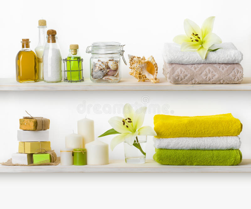 Wooden shelves with various spa accessories isolated on white stock photo