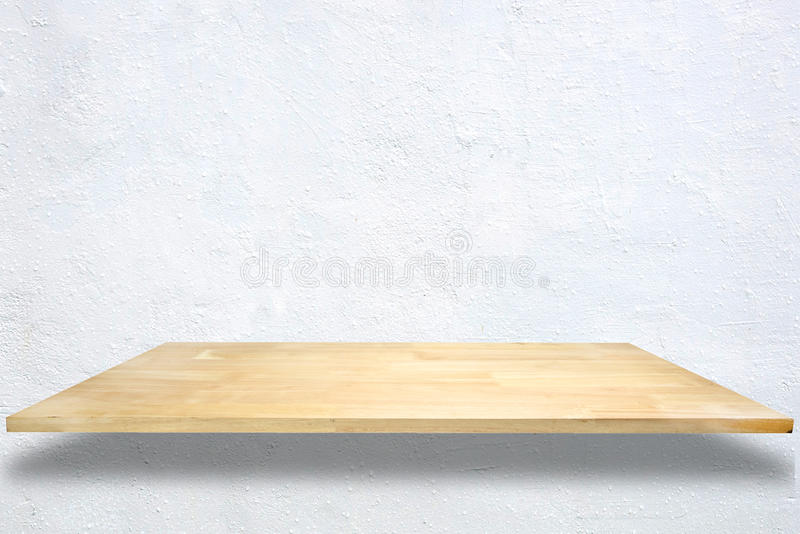 Wooden shelves on White cement wall background. royalty free stock photos