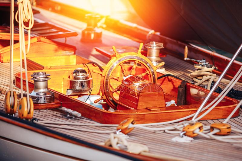 Wooden ship boat steering wheel is mounted on yacht stock image
