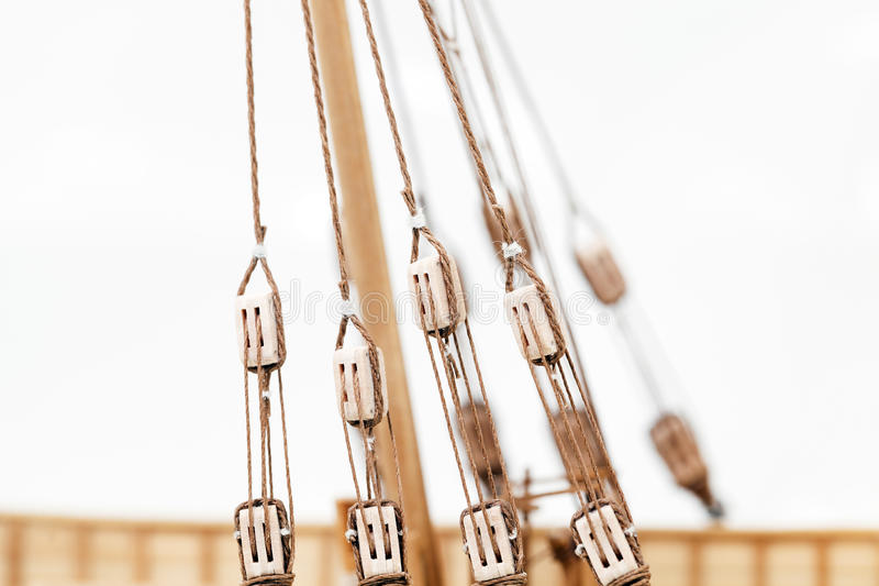 Wooden ship model. Photographed close-up of a model sailing ship, made by hand from the tree, a small depth of field , on a light background royalty free stock images