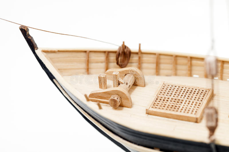 Wooden ship model. Photographed close-up of a model sailing ship, made by hand from the tree, a small depth of field , on a light background stock photography