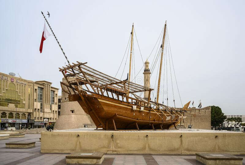 Wooden ship on the territory of the Museum of Dubai, UAE. Clear day 14 March 2020.  royalty free stock photography