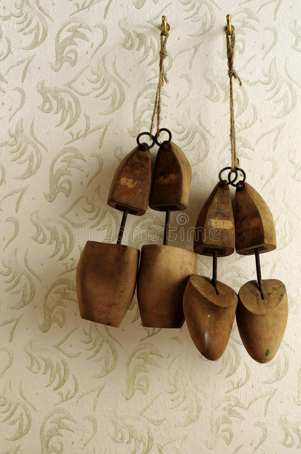 Wooden shoe stretcher mens and ladies still life royalty free stock photos