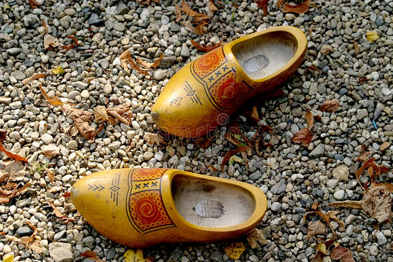 Wooden shoes in the gravel