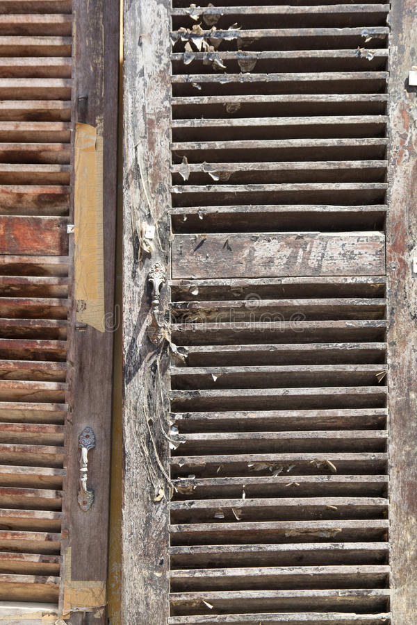 Wooden Shutters. Weathered wooden shutters vertical image for background use royalty free stock photography