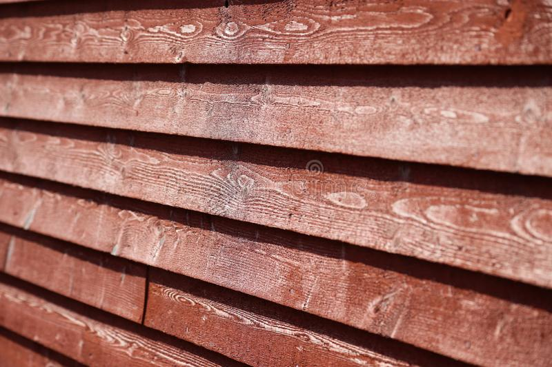 Red wood siding on an old barn building royalty free stock images
