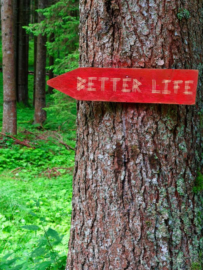 Wooden sign better life in the forest stock photos