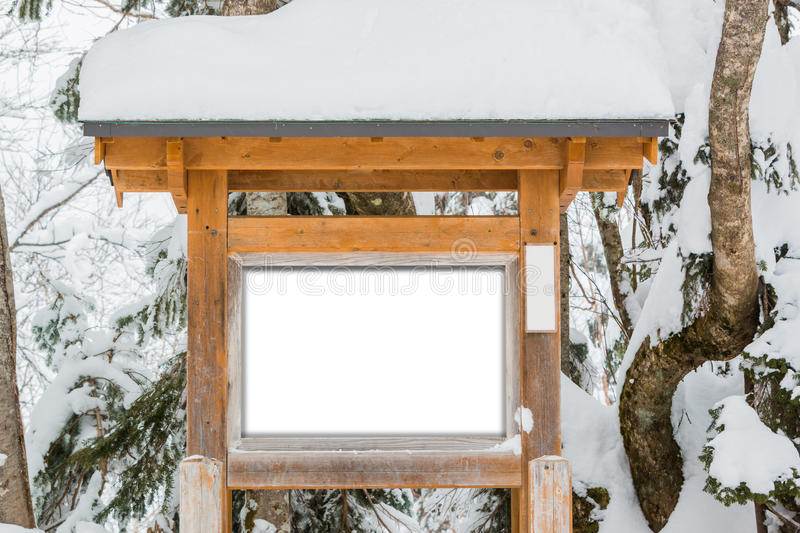 Wooden sign board, covered snow. stock images