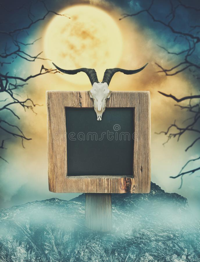 Wooden sign in dark landscape with spooky moon. Halloween design stock images