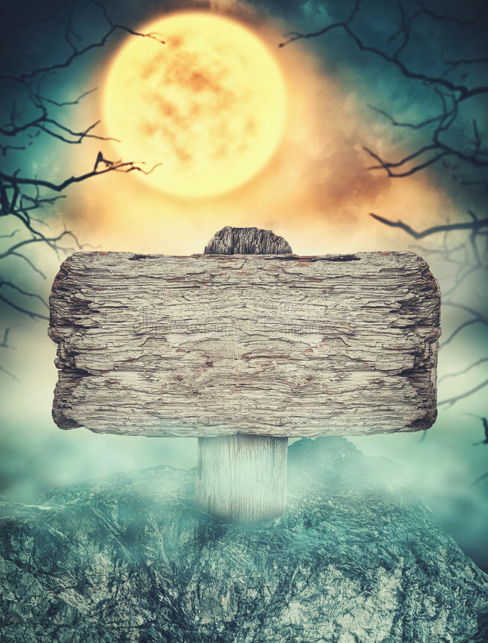 Wooden sign in dark landscape with spooky moon. Halloween design stock photography