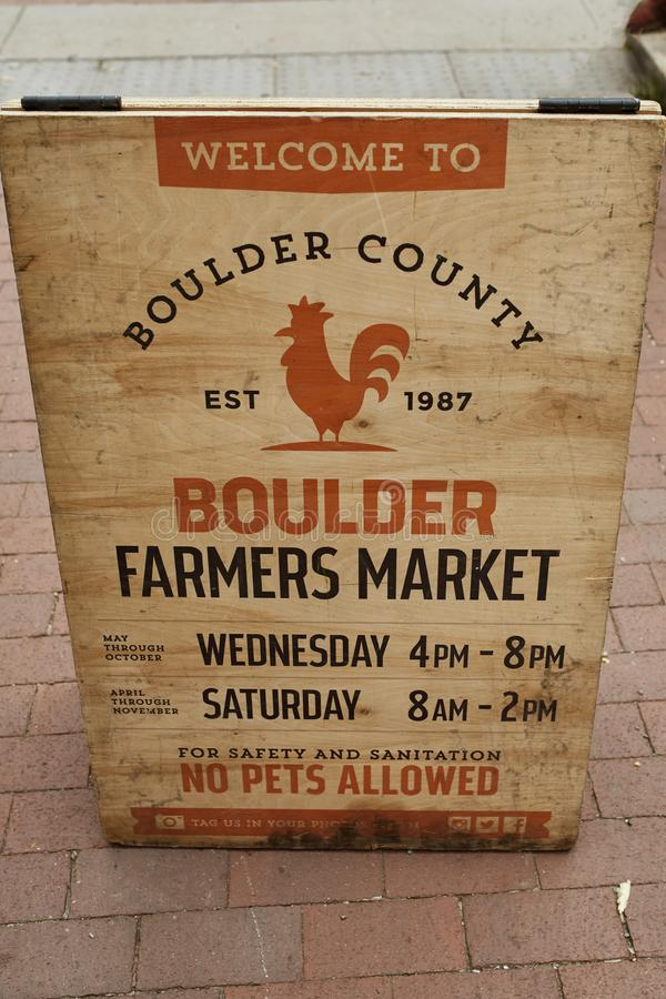 Summer season at Boulder County Farmer`s Market. Wooden sign at entrance of Boulder Farmers Market in Boulder, Colorado royalty free stock photography