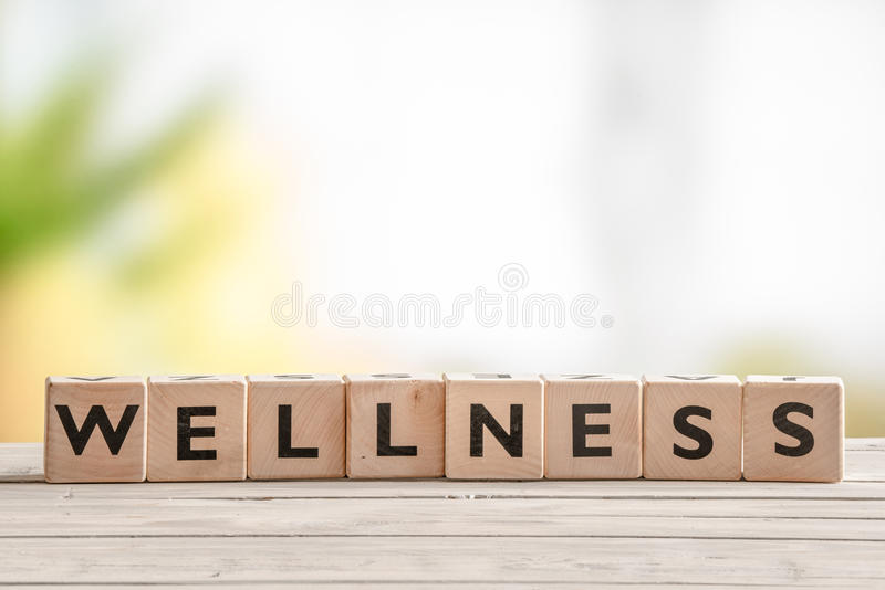 Wooden sign with the word wellness stock photography