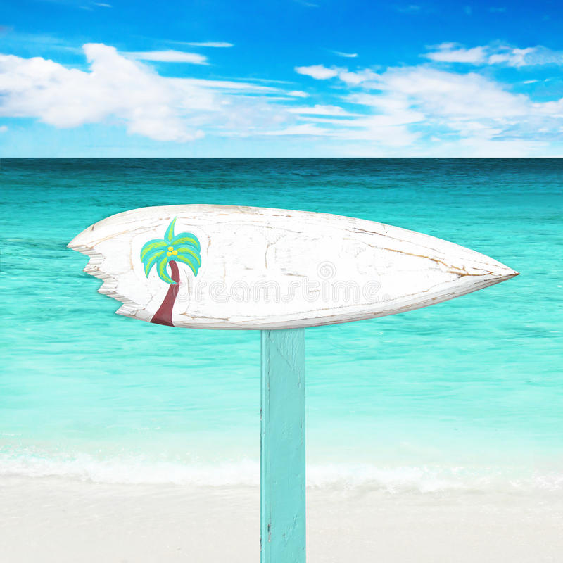 Wooden signboard on the beach. White wooden signboard on the beach stock images