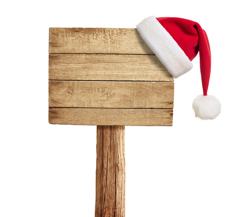 Wooden signboard with Christmas hat. Isolated on white royalty free stock images