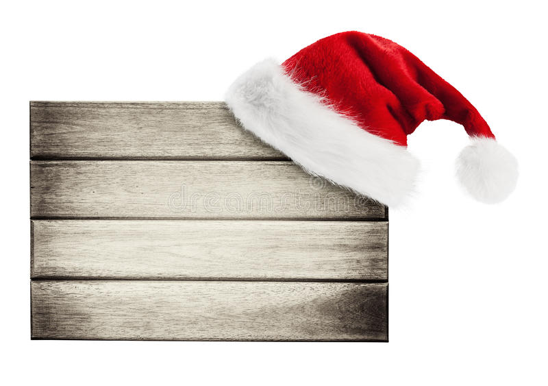 Wooden signboard with Christmas hat. Isolated on white stock images