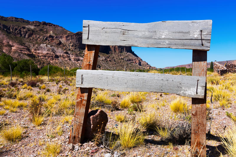 Wooden signboard. In the wild west area stock photos