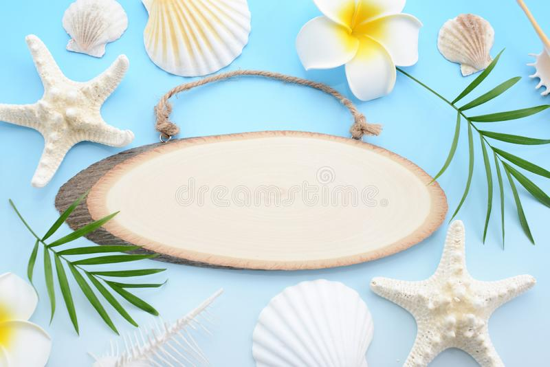 Wooden signboard. With sea shells stock photos