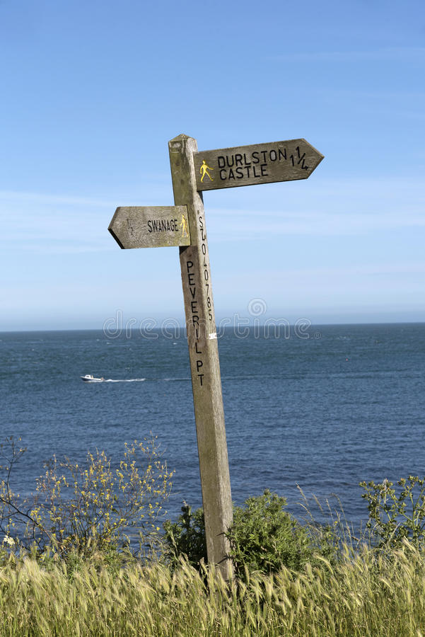 Wooden signpost on a coastal path. Signpost on the clifftop at Peveril Point near Swanage Dorset England UK royalty free stock image