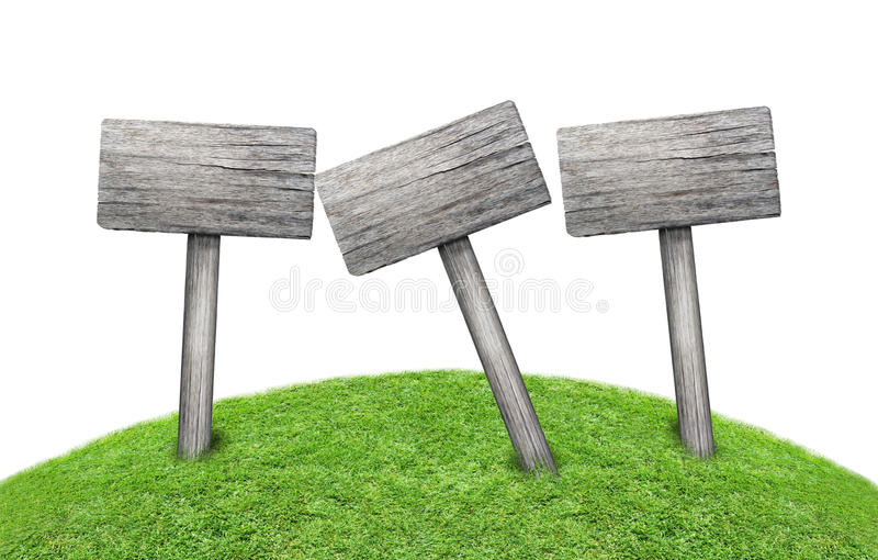 Wooden signpost on green meadow royalty free stock image