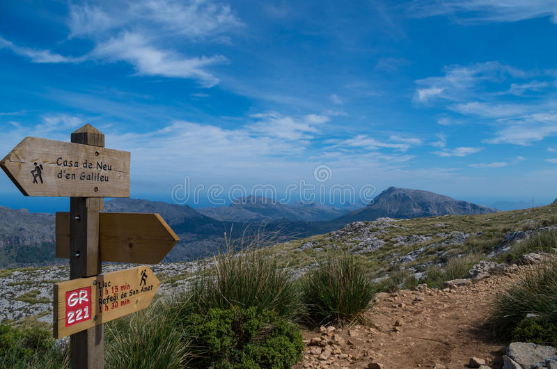 Wooden signpost for hikers in Mallorca along the GR 221 stock images