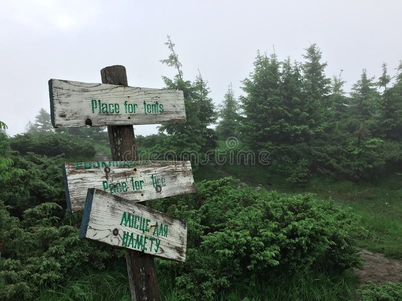 Wooden signpost in the mountains. royalty free stock image