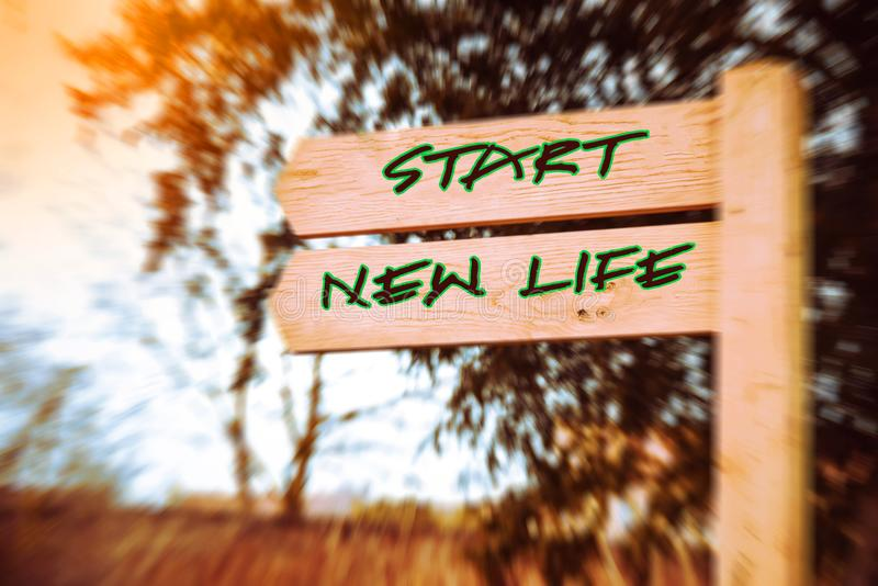 Start, new life signs. Wooden signpost with two arrows over speed effect backgroun, Start new life signs, Life change conceptual image stock photos