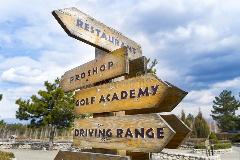 Wooden signs at the golf course. With clouds behind royalty free stock image