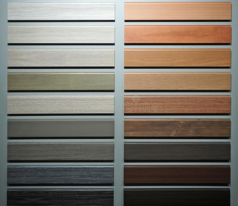 Wooden skirting board samples for different types of floor. Multi color assortment stock photography