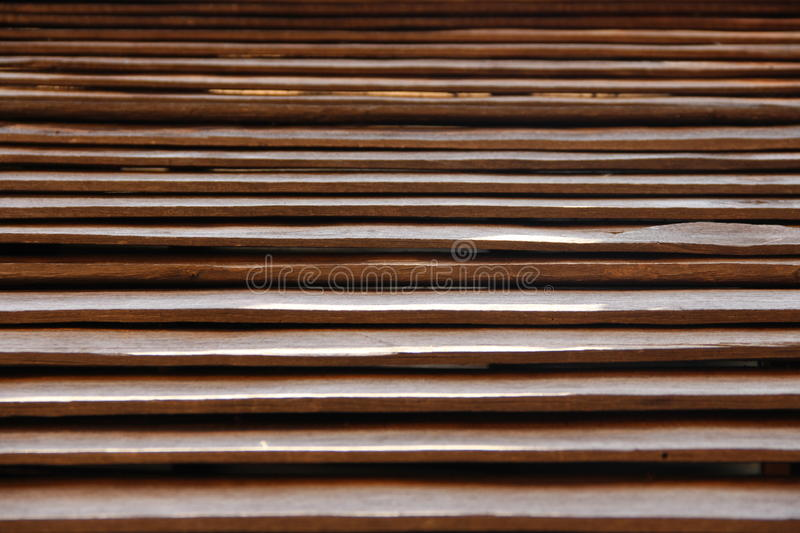 Wooden slat. Brown wooden slate as a house wall royalty free stock photography