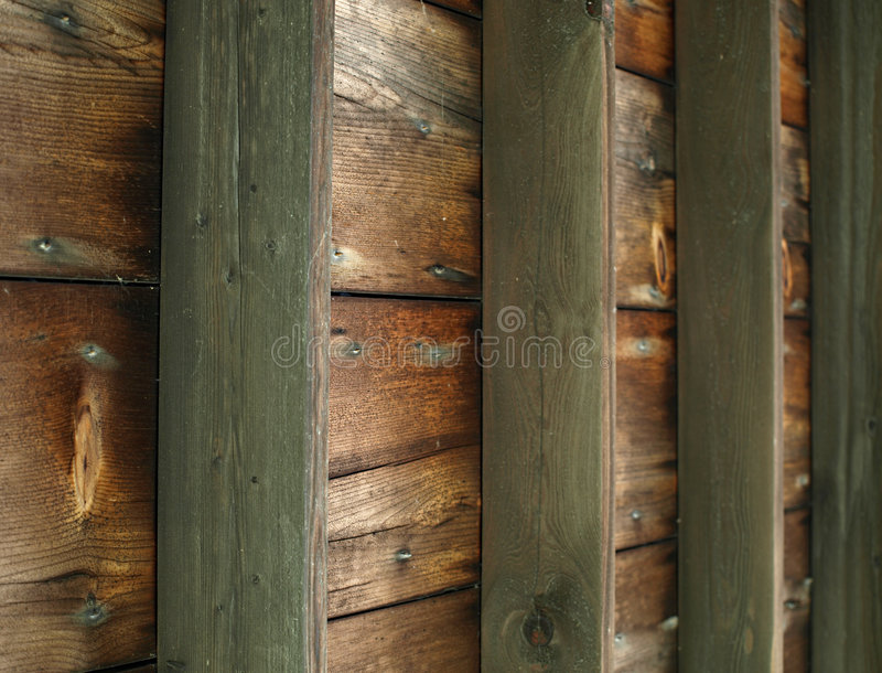 Wooden Slat Ceiling. An old wooden slat ceiling with exposed beams stock image