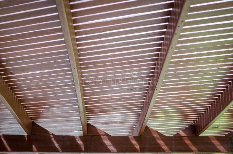 Wooden slat roof overhead walkway. Texture of Wooden slat roof overhead walkway to protect sunlight stock photo