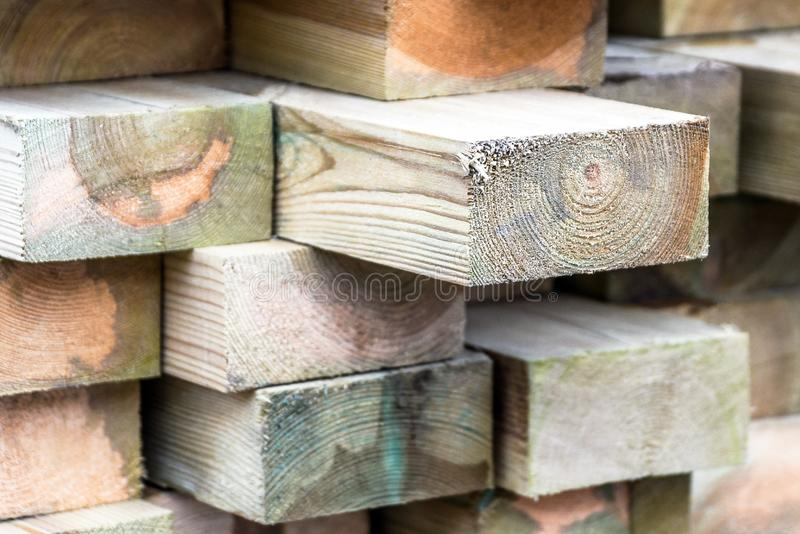 Wooden slats texture. Stack of wooden slats in timber logs storage stock photos