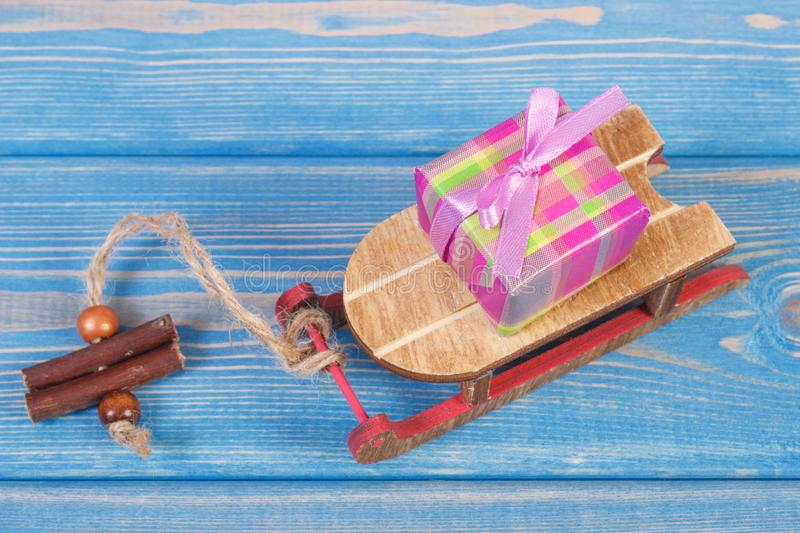 Wooden sled and wrapped gift with ribbons for Christmas or other celebration stock photography