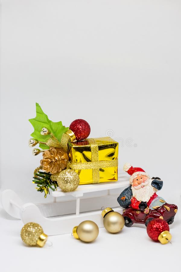 Wooden sledge with christmas gift. Vintage Christmas decoration. Happy New Year 2020 poster or greeting card with copy stock photography