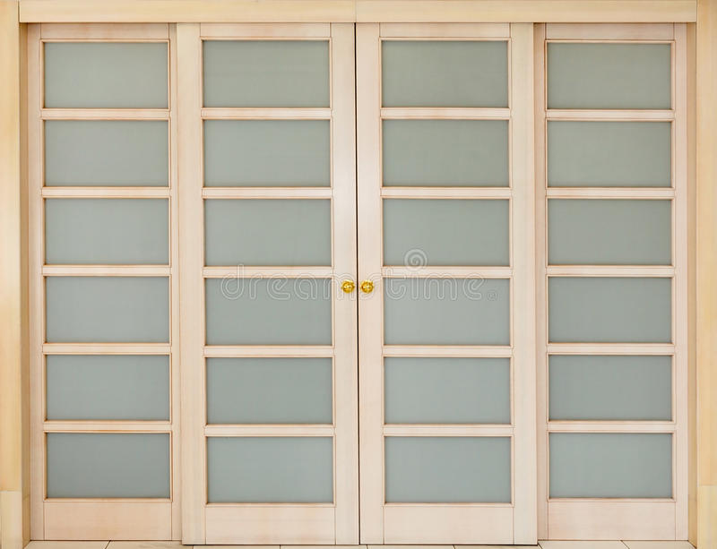 Wooden sliding door with glass inserts. royalty free stock photos