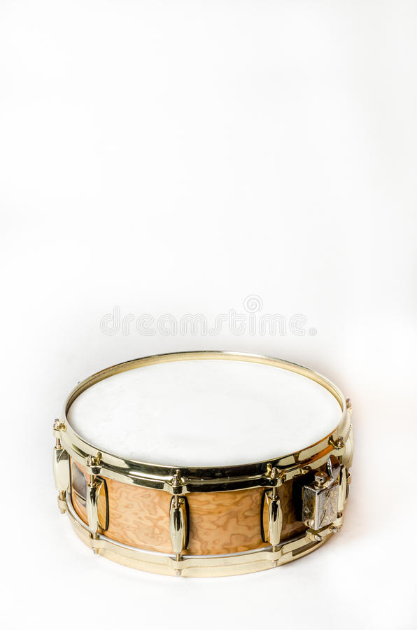 Wooden snare drum with gold rims. Top view of wooden snare drum on white bacground stock photos