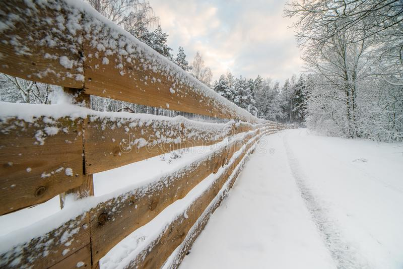 Wooden snowy fence royalty free stock image