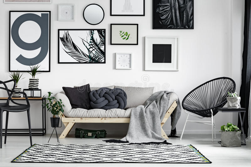 Wooden sofa with pillows stock images