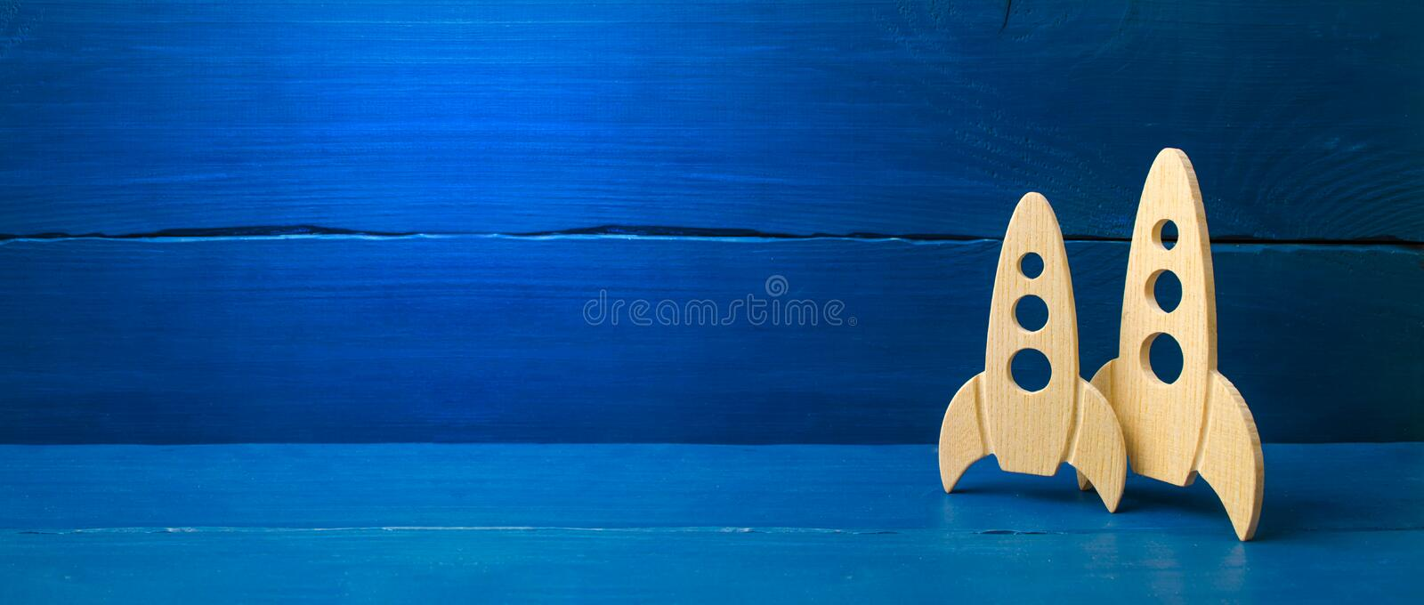 Wooden space rocket on a blue background. The concept of minimalism, high technologies and aspirations to conquer outer space. Business start-up. Education royalty free stock photos