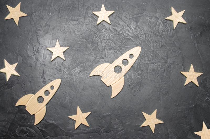 Wooden space rocket and stars on a dark background. The concept of space travels, the study of planets and stars. Education. And popular science. Resto style stock images