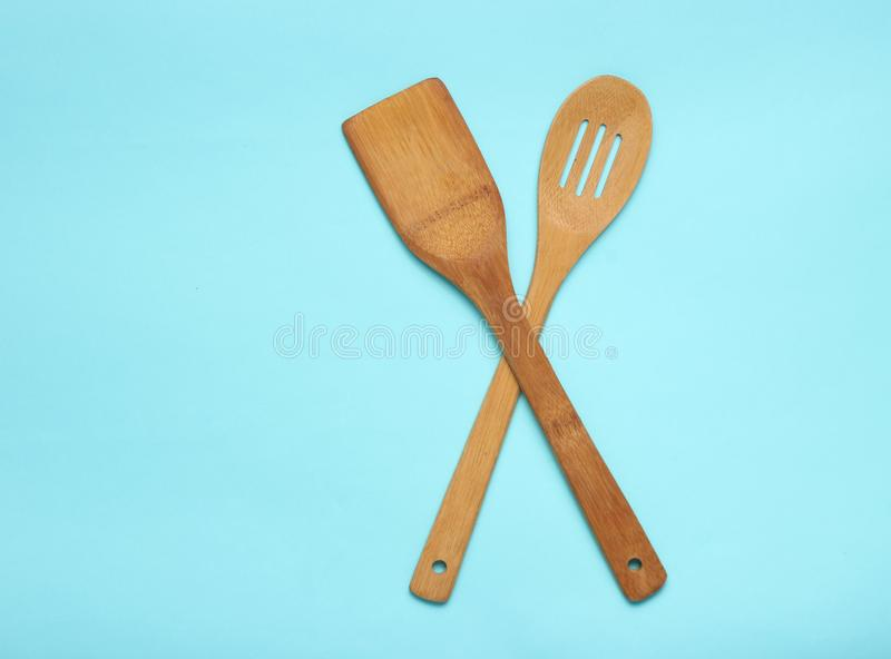 Wooden spatula for cooking on blue background. Kitchen concept, minimalism. Wooden spatula for cooking on blue background. Kitchen concept, minimalism stock images