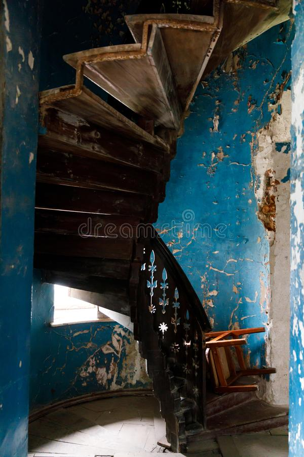 Different Architectural Styles Exterior House Designs: Old Wooden Spiral Staircase Stock Images