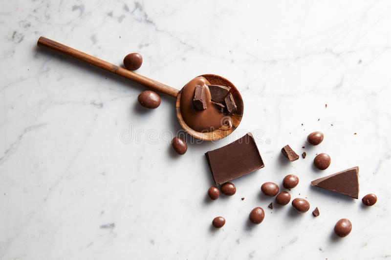 Wooden spoon with chocolate stock image