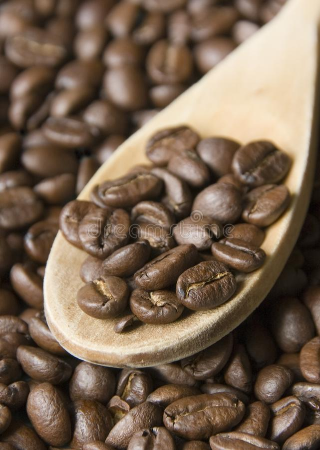 Wooden spoon and coffee stock images