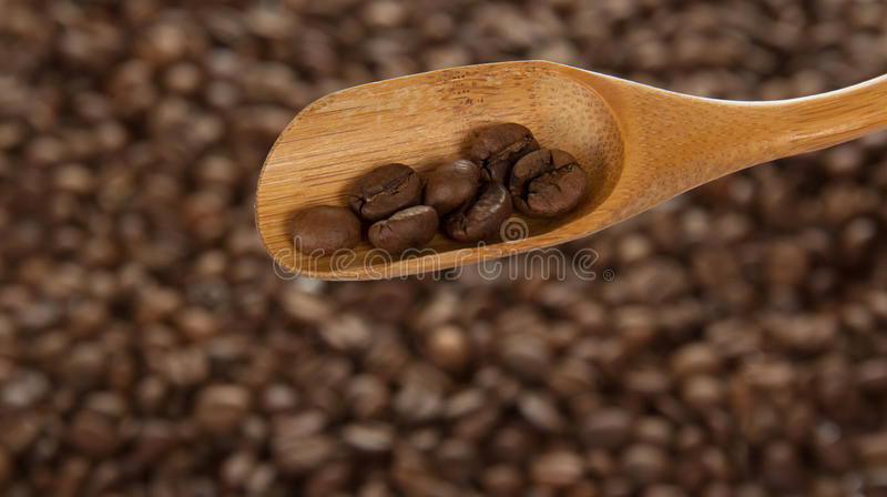 Wooden spoon with coffee