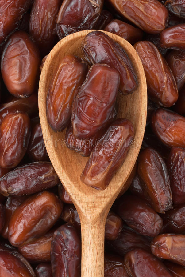 Wooden Spoon With Dried Dates Stock Photo