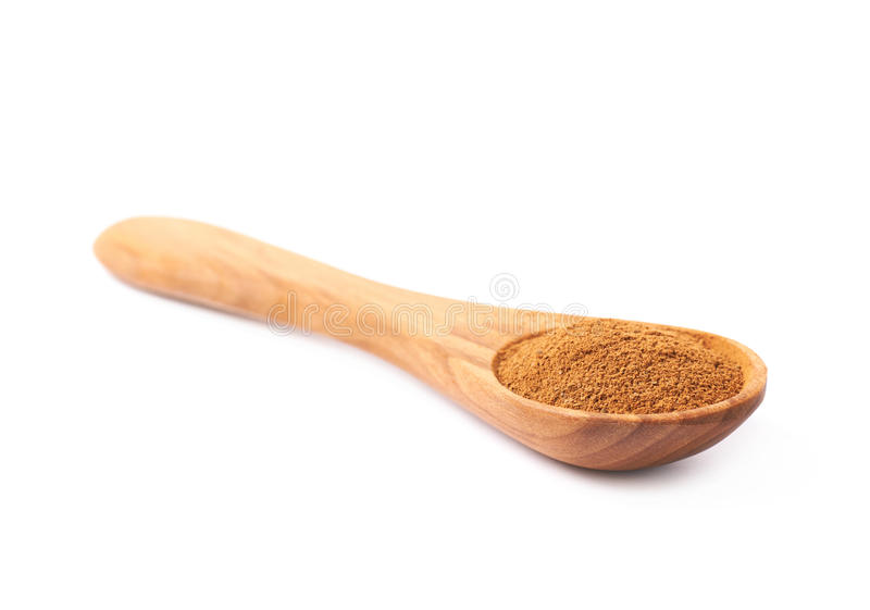 Wooden spoon full of cinnamon royalty free stock images