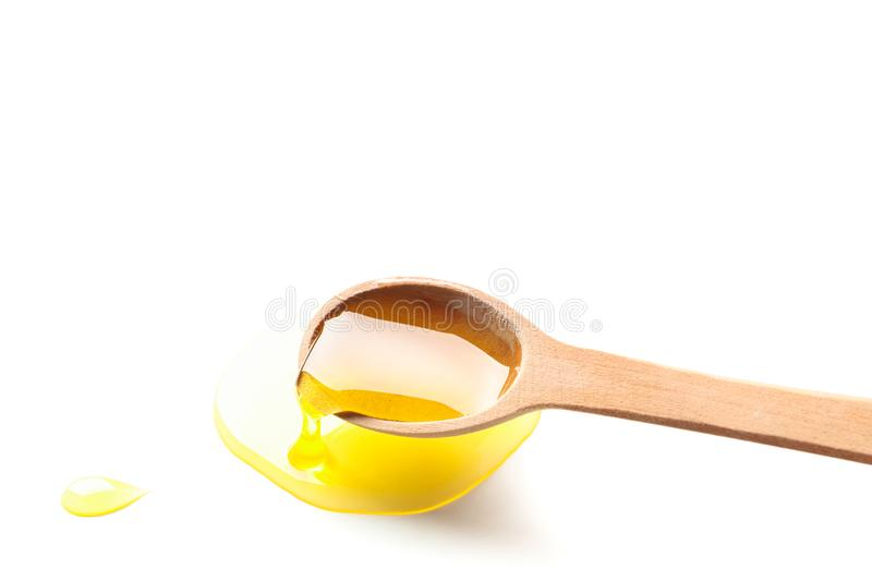 Wooden spoon with honey isolated on white background. Closeup royalty free stock image