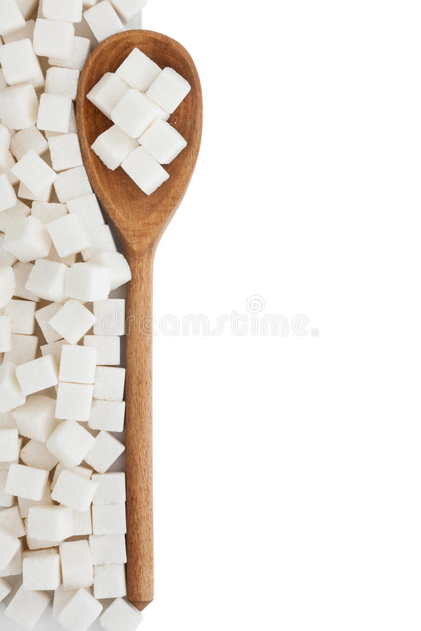 Wooden spoon with lump sugar royalty free stock image