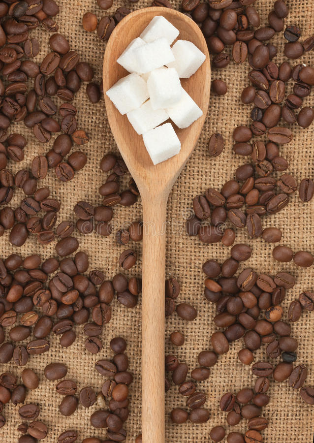Wooden spoon with lump sugar stock photo